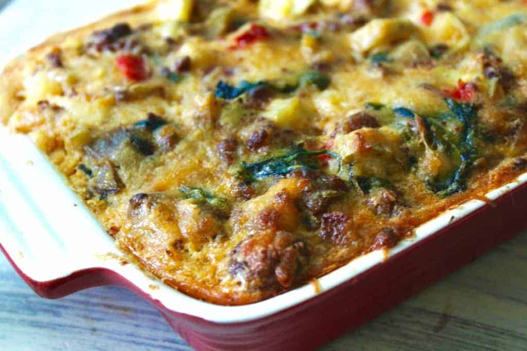 a baking dish of everything but the ktichen sink breakfast casserole is a great way to use up leftovers in your fridge and cook a whole30 breakfast
