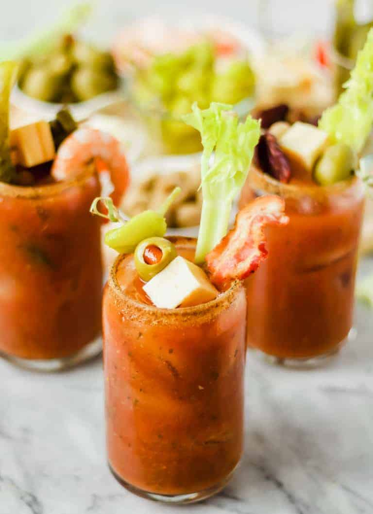 three bloody marys with toppings
