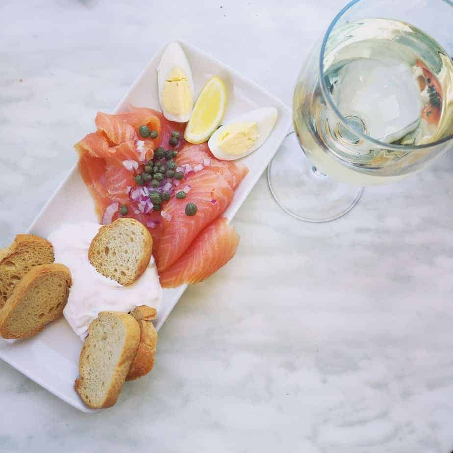 southpark cafe monte smoked salmon and glass of white wine