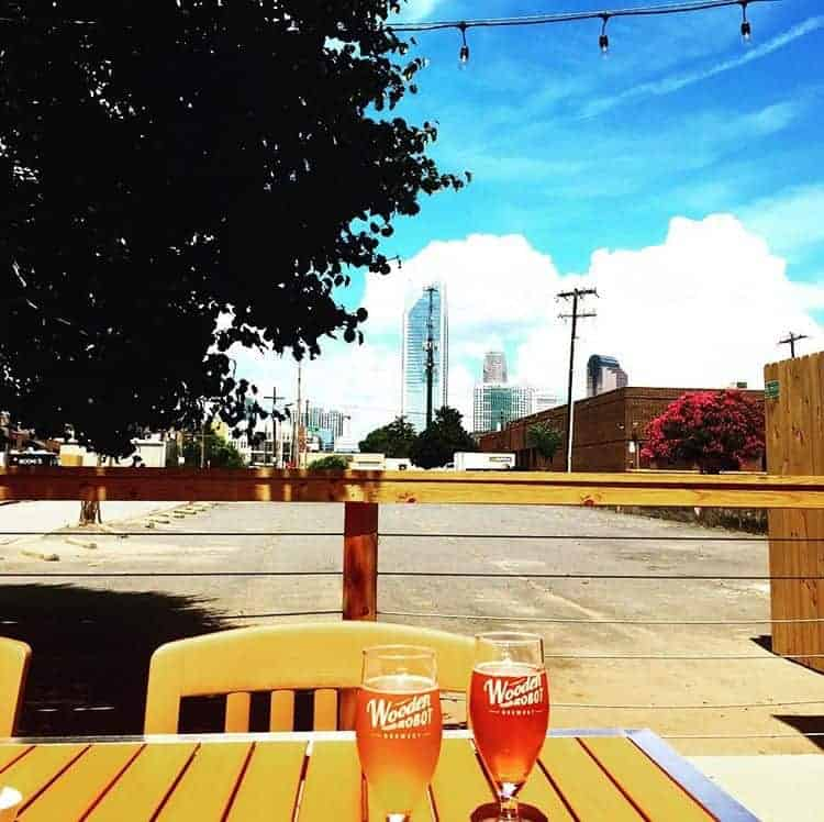 view of the charlotte skyline from one of the best breweries in charlotte, wooden robot