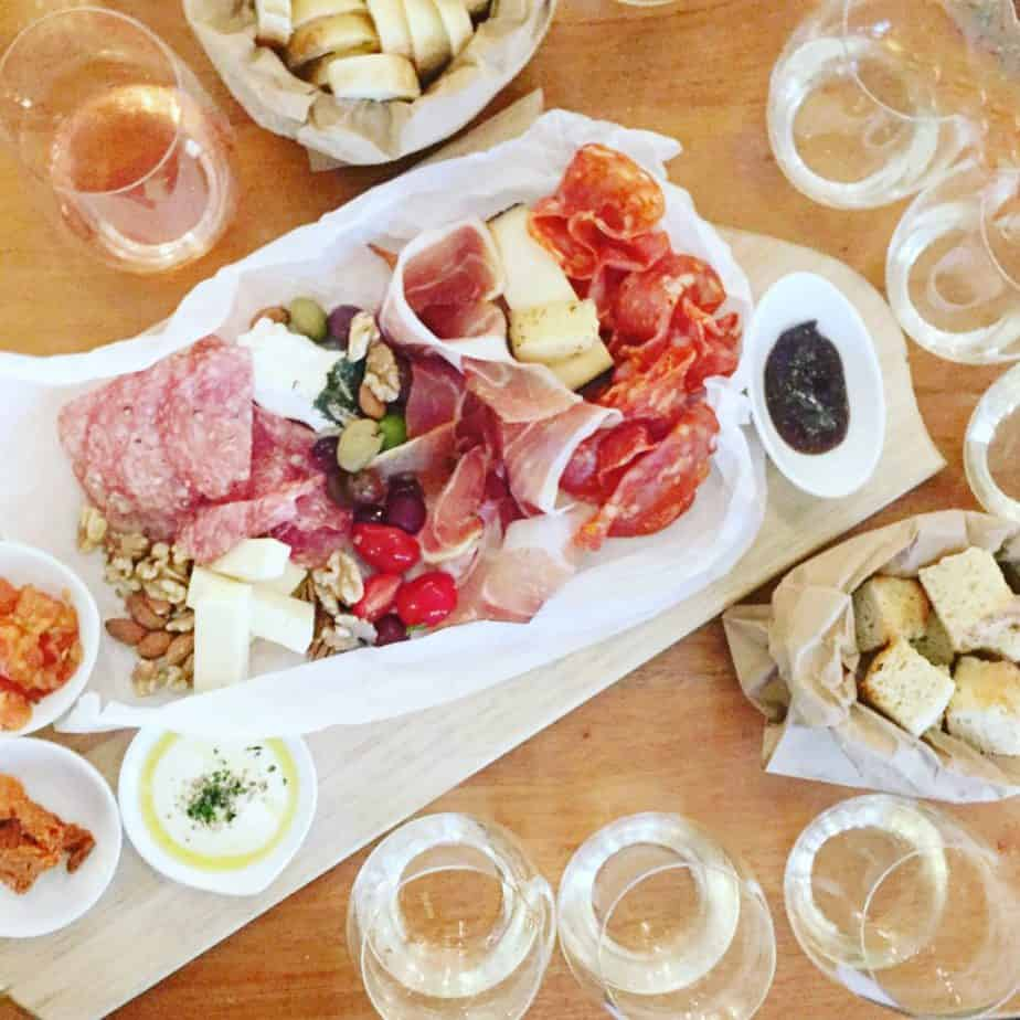 charcuterie board and wine flights on a wood table