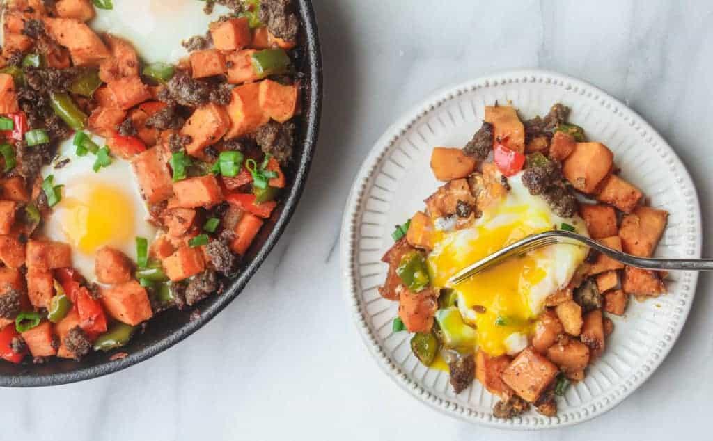 cast iron pan full of sweet potato hash is a great whole30 breakfast idea