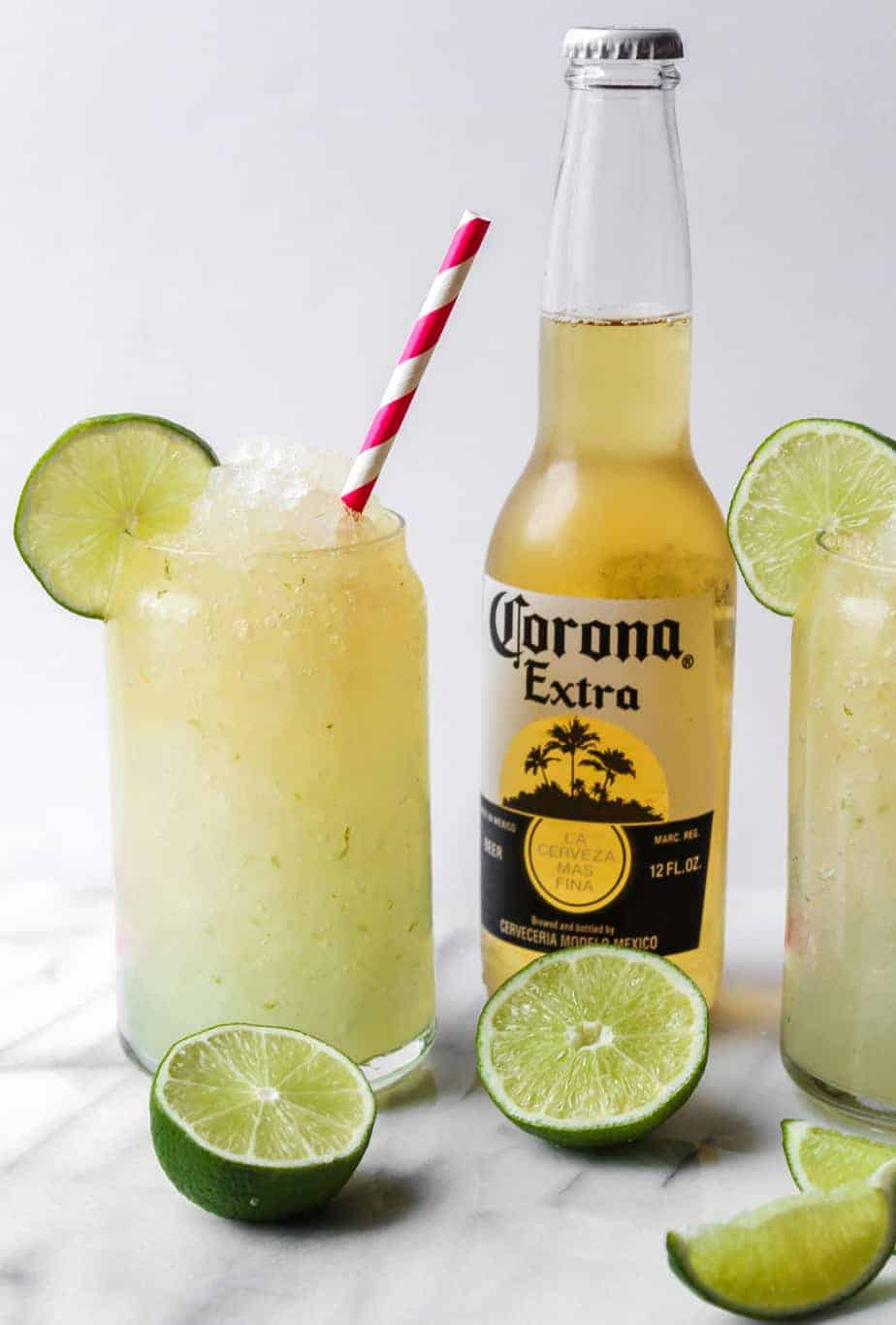 bottle of corona with limes and corona cocktail
