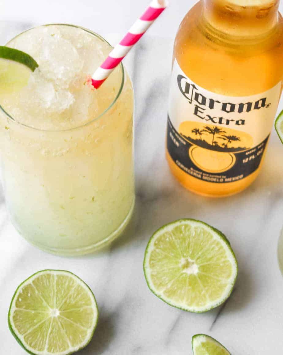 bottle of corona extra with limes