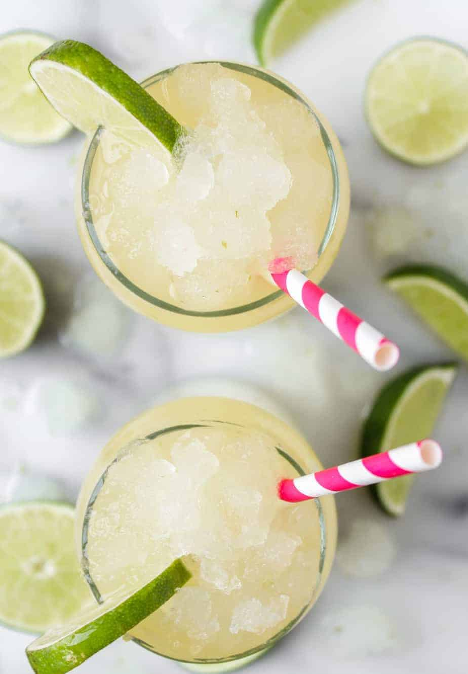 corona cocktail with limes and corona extra beer and pink striped straws