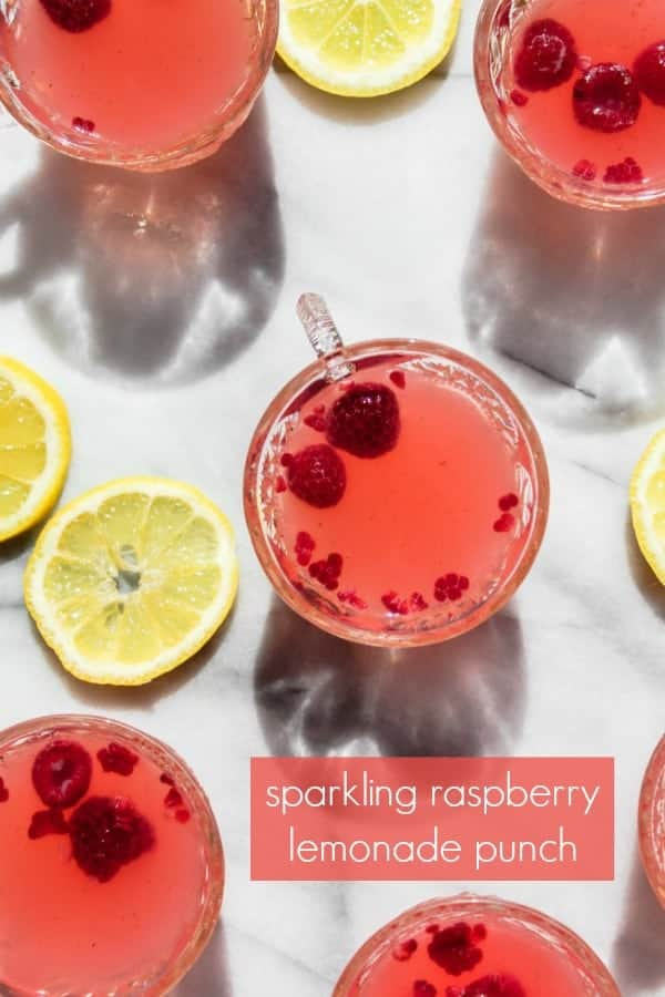 sparkling raspberry lemonade punch is an easy, refreshing drink for summertime celebrations! with both a mocktail and cocktail version, this drink recipe is perfect for a baby shower, bridal shower, party or as a refreshing drink on a hot summer afternoon.