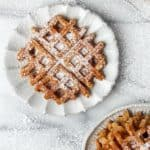 no shame in our pumpkin flavored everything game! No need to buy frozen waffles when you can easily make the real thing at home! these pumpkin waffles, from The Ultimate Kids' Cookbook, are full of fall flavors and so easy to make they've become a seasonal Sunday morning staple in our house. this fall recipe is the perfect breakfast recipe or brunch recipe, and is such an easy recipe they feature just a few pantry staple ingredients and just one bowl!