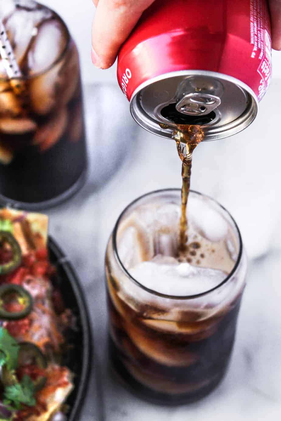 loaded grilled nachos and coke pour