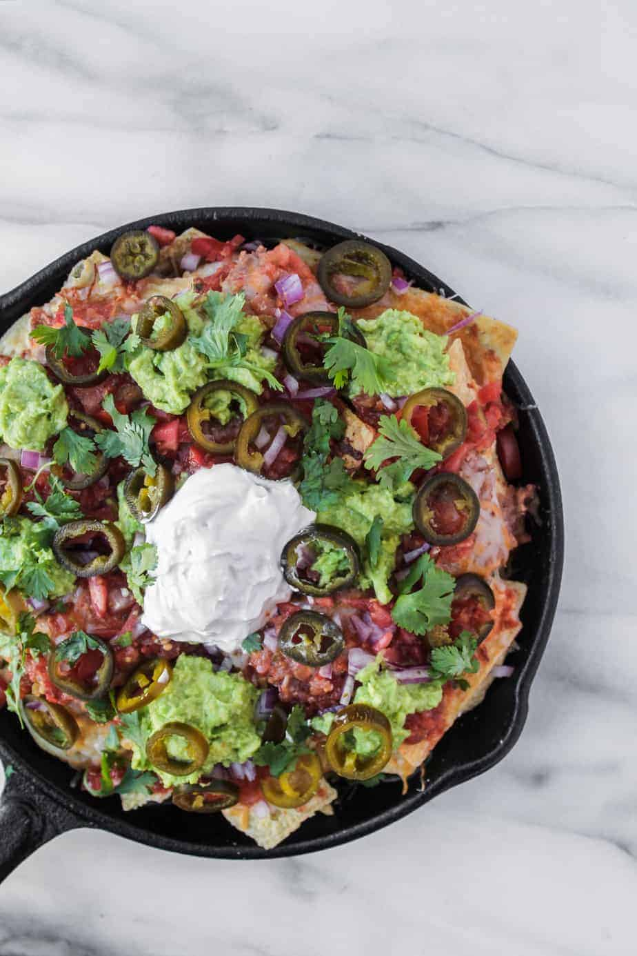 loaded grilled nachos in cast iron skillet