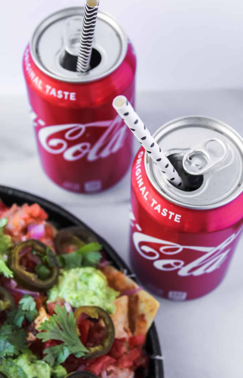 loaded grilled nachos with coke with straws