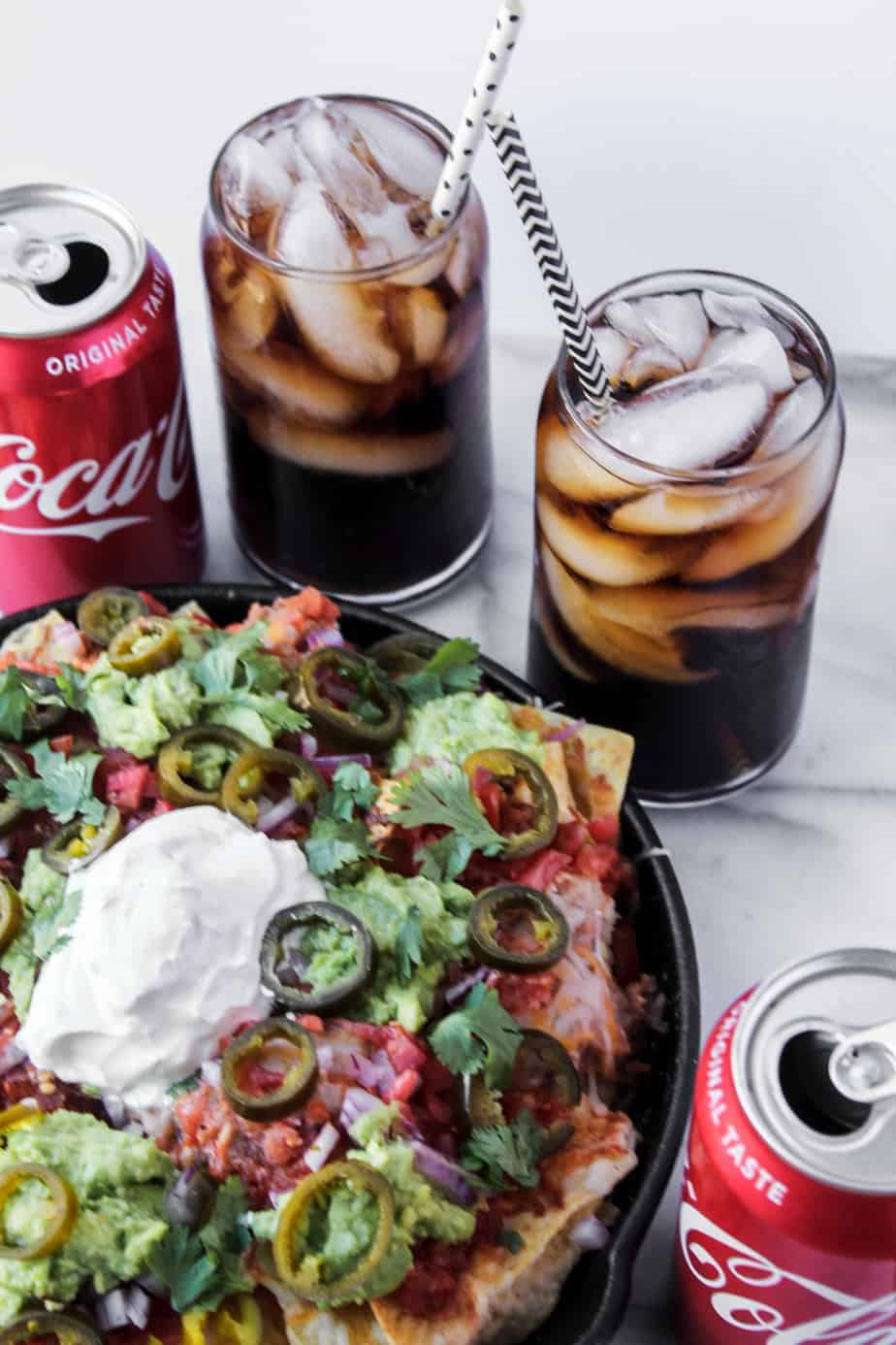 loaded grilled nachos with ice cold coca cola