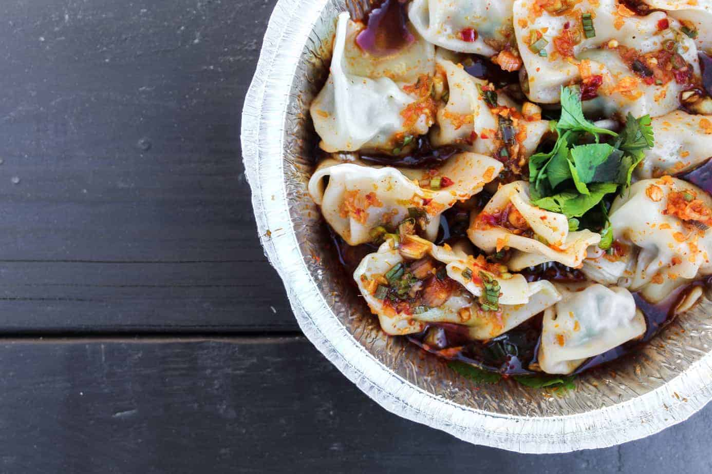 pork and chive dumplings from the dumpling lady on a picnic table