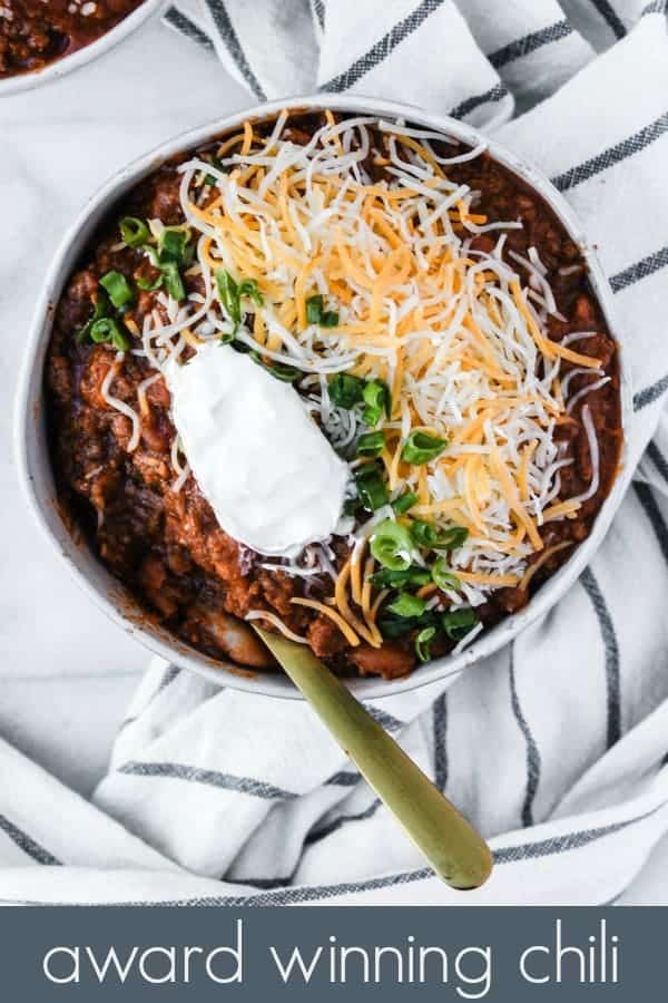 my mom's award winning chili recipe is one of the best comfort food meals! it's so easy to make just using one pot, and has tons of yummy flavors with the addition of bacon and pinto beans. you can add as much chili powder as you want to make it as spicy as you like! plus, the post includes tips on how to use up the leftovers and how to freeze!