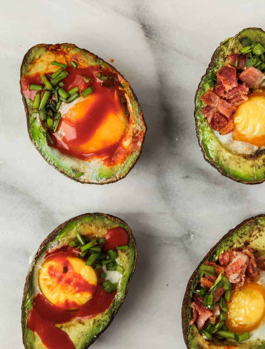 easy whole 30 breakfast recipe idea: baked eggs in avocados with hot sauce