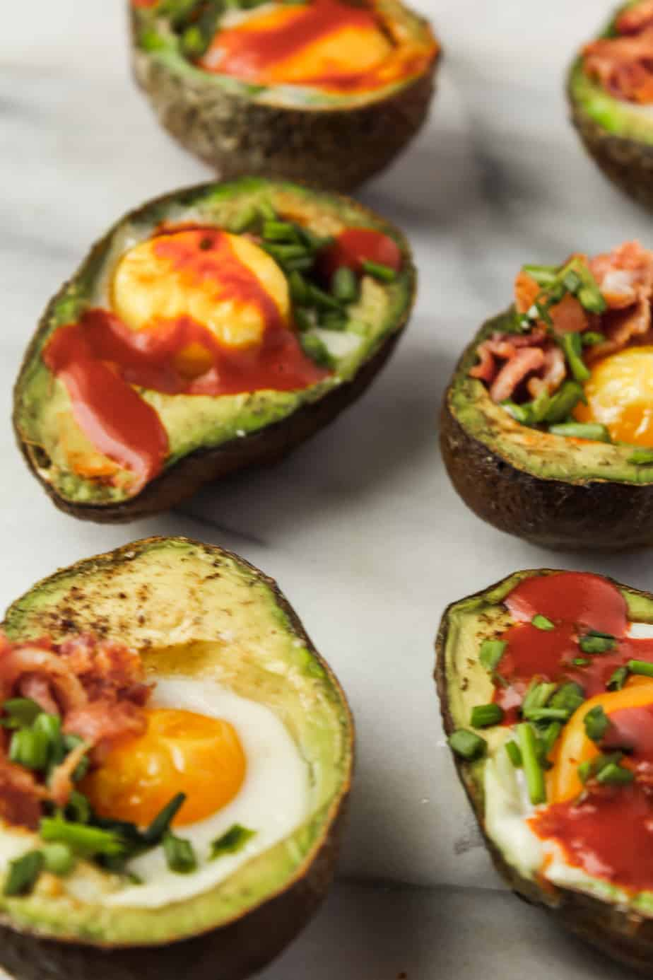 whole30 breakfast ideas: baked eggs in avocado with hot sauce