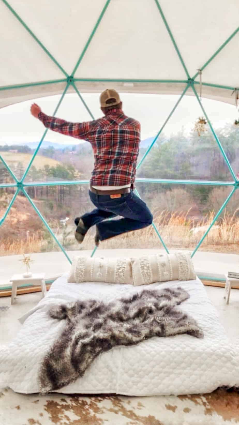 jumping for joy at asheville glamping