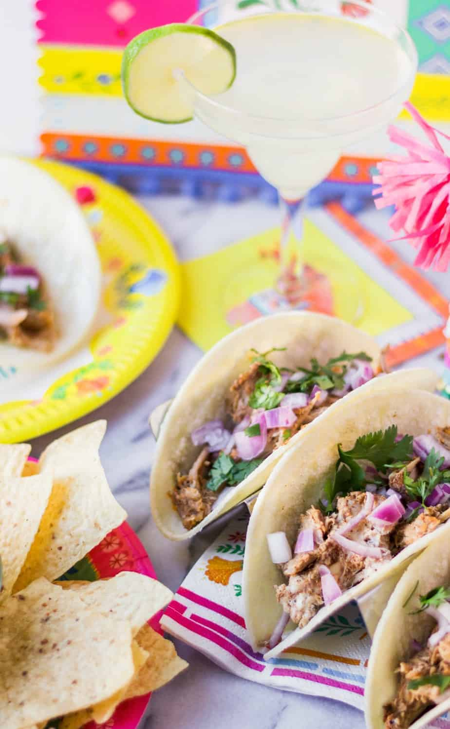 carnitas tacos for a taco bar party on corn tortillas