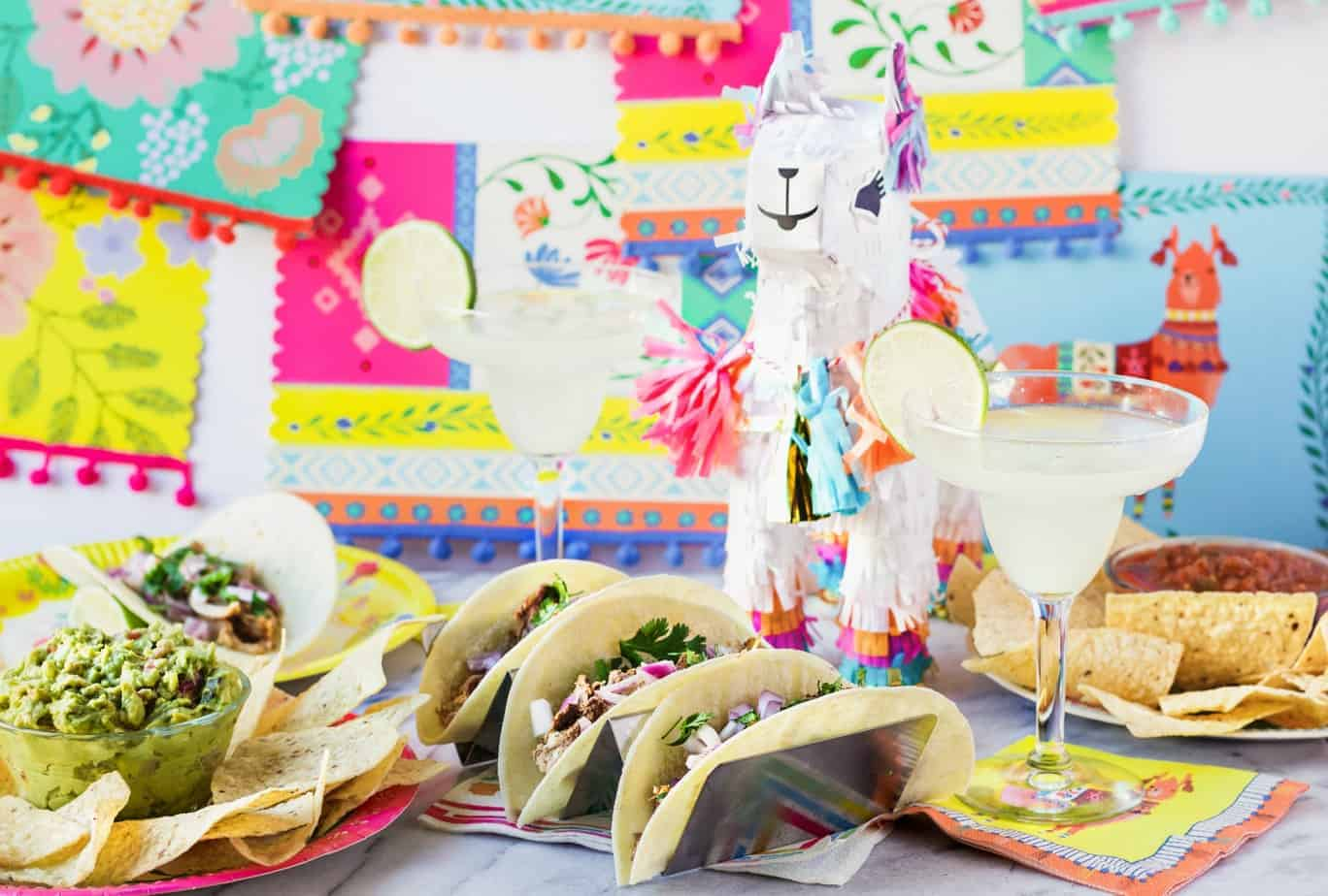 taco bar party with a llama pinata