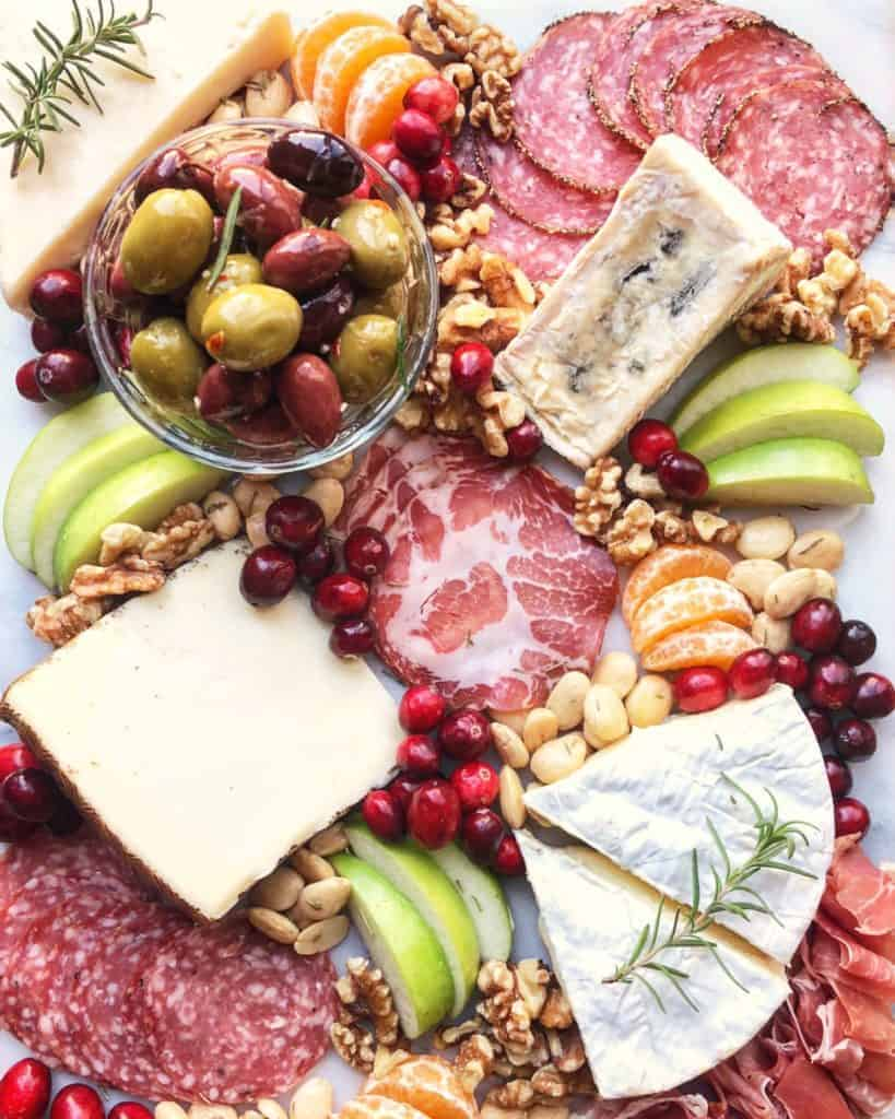 a variety of cheeses on a board how to create a cheese platter