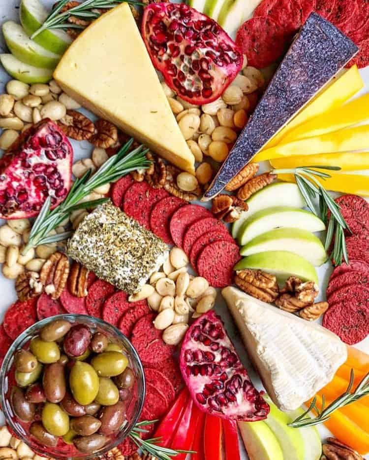 how to make a cheese platter with brightly colored cheese crackers and fruit