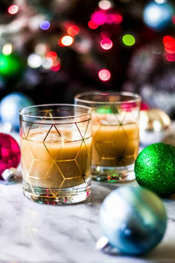 two rocks glasses with christmas white russian cocktails made with eggnog