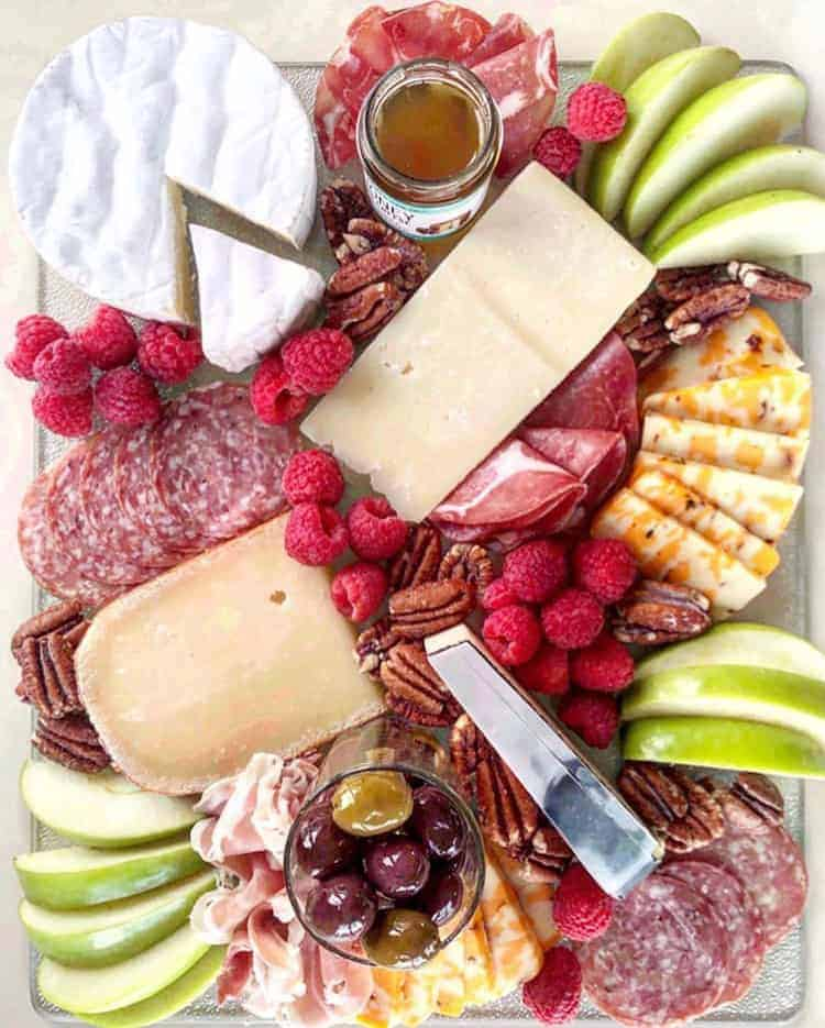 wheel of brie on a cheese platter