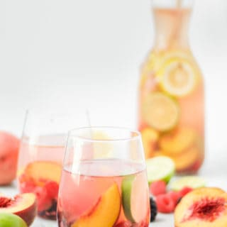 sparkling peach sangria with fresh berries and peaches
