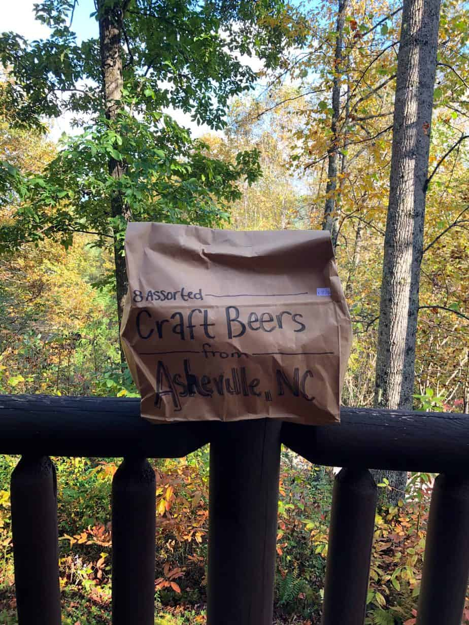 brown bag on top of a railing with trees in the background
