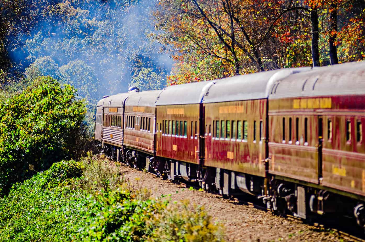 great smoky mountains railroad passenger car traveling through the trees