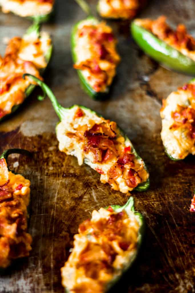 a close up of a half of a jalapeno pepper stuffed with pimento cheese and bacon