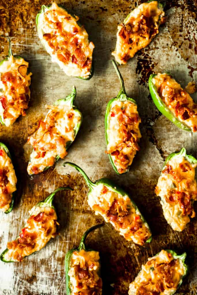 pimento cheese jalapeno poppers on a metal sheet tray