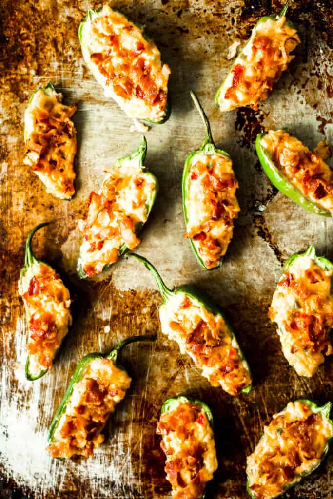 pimento cheese poppers lined up on a metal sheet tray