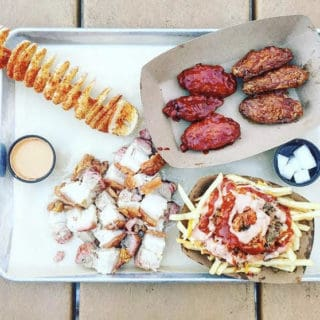 wings, kimchi fries, pork belly and potato on stick at seoul food meat company in charlotte nc