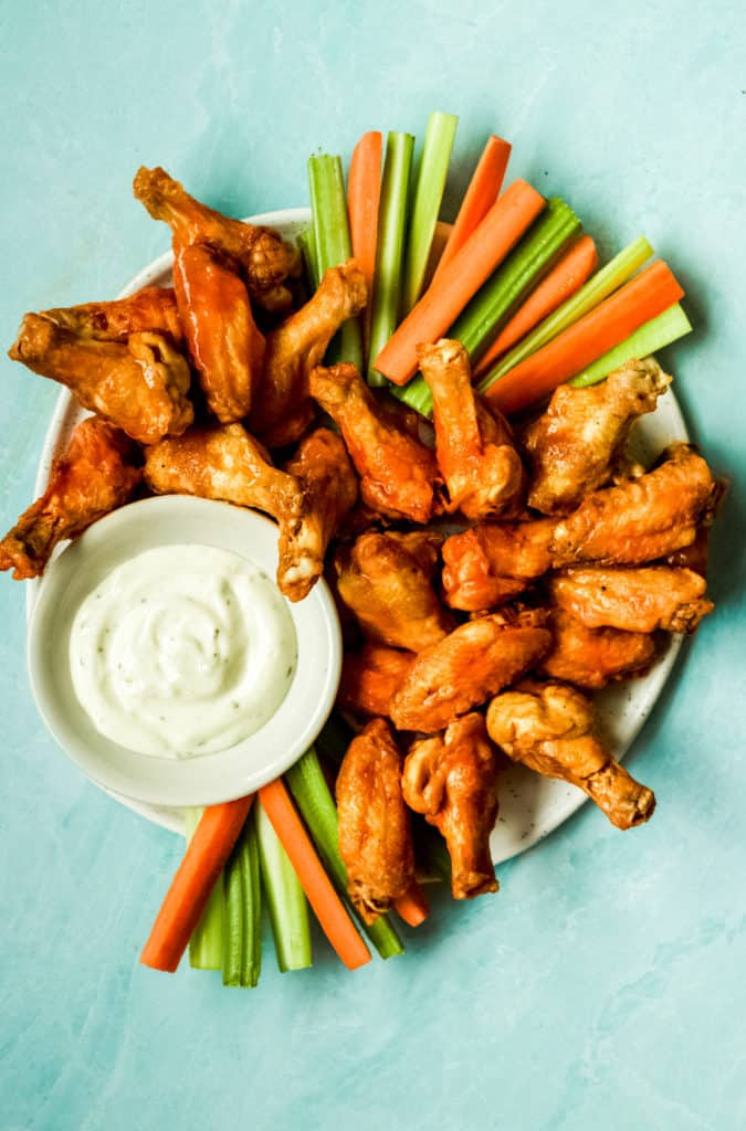 a big plate of buffalo wings, carrots, celery and ranch for dipping
