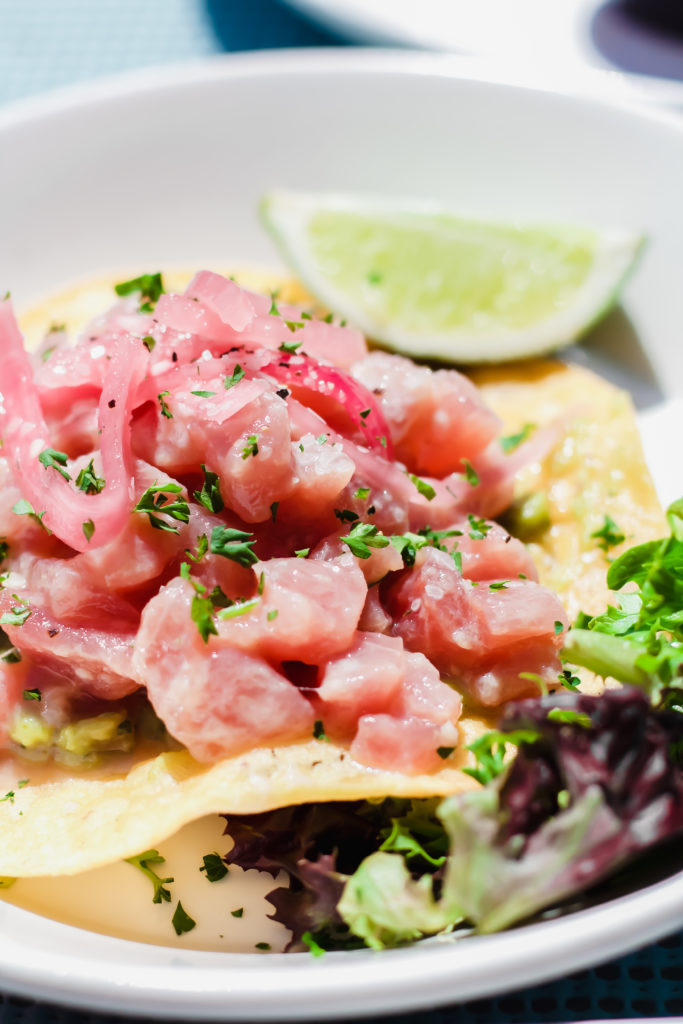 pink tuna ceviche on a crunchy tortilla garnsihed with greens and a lime wedge at bahia beach house in atlantic beach