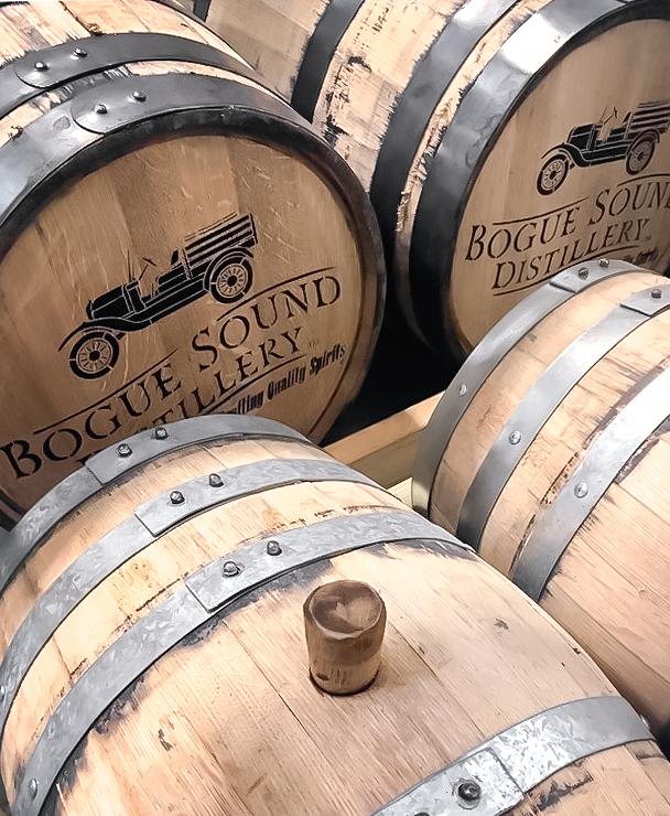 whiskey barrels with bogue sound distillery logo