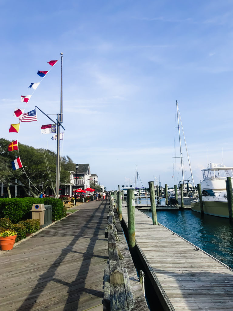 waterfront boardwalk on front street in Beaufort NC with flags waving in the wind