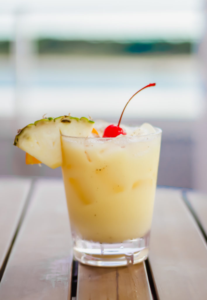 painkiller cocktail in a glass on a wooden table