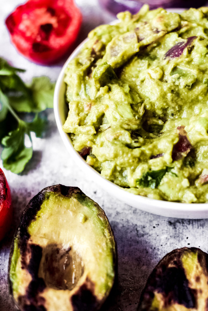grilled vegan guacamole dip in a white bowl