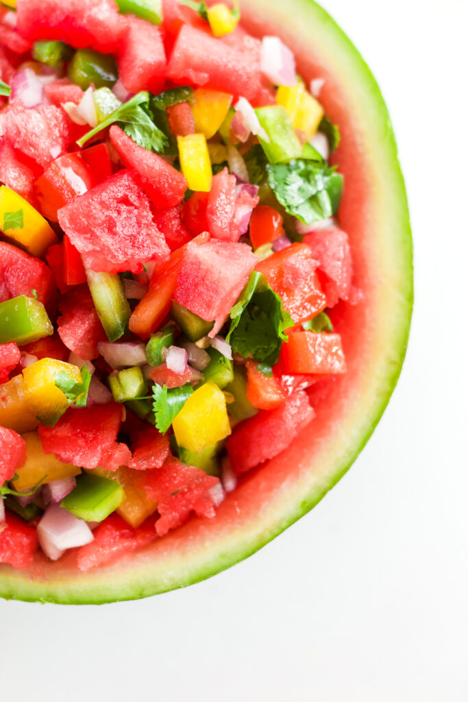 overhead shot of watermelon salsa on a white background